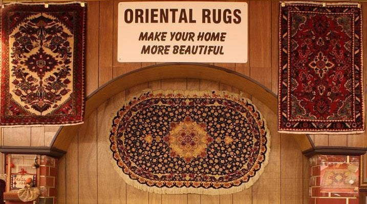 oriental rugs hanging on wall